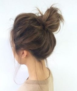 tying your hair up in a bun can help curl your locks