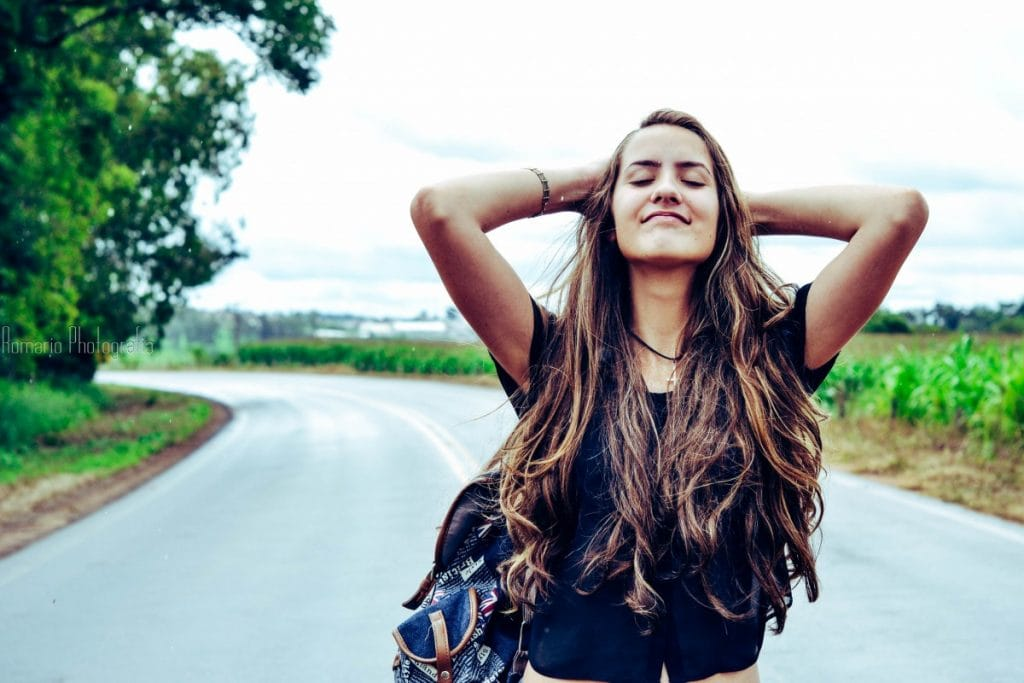 A long-haired girl on the road